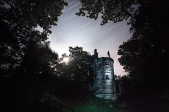 Warder of the Tower (Ben Lockett) Tags: self mystery moonlight torch nightphotography light moon leaves trees woodland woods knyperselypool knypersely longexposure 1740l 5d canon photoshop climbing urbex warderstower warder gamekeeper house miniature castle standing person stars sky forest silhouette tower startrails night