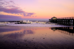 Pink Hue (Moniza*) Tags: ocean sunset sea sky seascape reflection beach nature water silhouette club clouds sunrise landscape dawn pier newjersey twilight fishing sand nikon rocks waves nj rocky explore shore jersey bluehour jerseyshore oceangrove d90 explored moniza