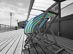by the seaside.. (dawn.v) Tags: uk england pier seaside sunny dorset april bournemouth deckchairs selectivecolour bournemouthpier englishseaside lumixtz25 editedinaviary
