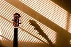 Toolshed (EnthusiasticSojourn) Tags: wood light shadow musician music brown sun sunlight white abstract wall neck golden nikon shadows artistic guitar shapes heads yamaha blinds strings nut nikkor tuning headstock d5100 d3100