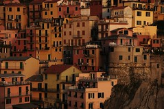 The Golden Village (Saumil U. Shah) Tags: world lighting travel houses light sunset sea wallpaper italy cliff color colour heritage tourism colors gold golden evening coast nationalpark seaside italian colorful flickr riviera italia colours village five liguria tourist villages illuminated unesco hills coastal hour terre cinqueterre colourful towns manarola desktopwallpaper goldenhour cinque select italianriviera worldheritage shah saumil saumilshah