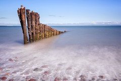 Porlock Groynes 05 (Photograferry) Tags: exmoor nationalpark uk southwest england outside nopeople landscape nature 2016 porlock beach coast ocean longexposure groynes weathered wooden posts sea smooth