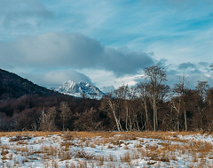 Melting snow. (brunoffelipe) Tags: trees sky landscape frozen clouds forest mountains winter nature travel light snow mountain ice wild patagonia south america argentina melting natureza photograph pics