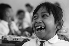 Laugh Out Loud-DSC_4940 (thomschphotography3) Tags: indonesia java asia southeastasia school blackandwhite children girl laughing laughter portrait streetphotography indoor bokeh