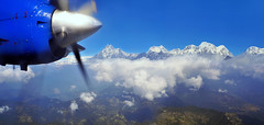 View sky from an airplane,mountains and sky outside the window (marozn) Tags: window plane view wing earth sky aircraft fly clouds travel atmosphere horizontal horizon airliner stratosphere vehicle transport airplane high aviation machine transportation altitude scenic trip height nature land ground tranquil flight cloudscape journey fields landscape air outdoors summer spring glass see nepal kathmandu asia lukla jet speed fast national park propeller