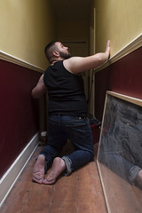 Walls Closing In (Scott A Hamilton) Tags: male portrait houseboy cub bear barefoot barefeet housework