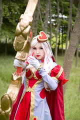 Ashe Heartseeker (AtelierRaza) Tags:  cosplay forest tree light bokeh green costume female outdoor anime manga people rainy rain cloud valentine league legend lol bow archer ashe heart red white hair silver coser video game mmo canon 50mm