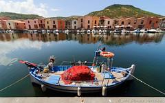 Bosa (Daniele Varrazzo) Tags: boat reflection river symmetric water wideangle