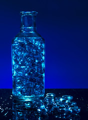 Still Got the Blues (darrenball189) Tags: glass bottle blue pebbles stones hard light background