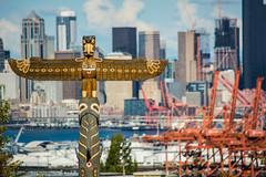 Seattle   |   Totem Pole (JB_1984) Tags: totempole totem carving city skyline vista portofseattle crane tower skyscraper downtown westseattle seattle kingcounty washington wa unitedstates usa