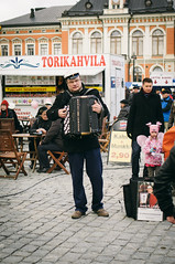 May Day in Kuopio, Finland (Janneaa) Tags: street musician finland spring cafe sony streetphotography accordion townhall mayday kuopio labourday marketsquare internationalworkersday studentcap vsco sel35f18 sonynex5n vscofilm