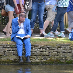 Book and Blue Suit (mitchell_dawn) Tags: passingthetime absorbed oblivious bluesuit blue reading book literature pageturner novel riverbank riverwindrush bourtononthewater passthetime passerletemps passarotempo zeitvertreiben pasareltiempo flickrfriday