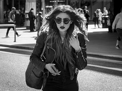 Flowing Locks (Leanne Boulton) Tags: people monochrome urban street candid portrait portraiture streetphotography candidstreetphotography candidportrait streetlife young woman female pretty face facial expression look emotion feeling beauty beautiful mane hair flowing movement motion lipstick makeup sunglasses style stylish tone texture detail depthoffield natural outdoor light shade shadow backlit city scene human life living humanity society culture fashion canon 7d 50mm black white blackwhite bw mono blackandwhite glasgow scotland uk
