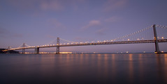 It's a thing, plate 7 (Michael Dunn~!) Tags: baybridge bridge clouds embarcadero itsathing longexposure photowalking photowalking20110731 photowalkingsolo reflections sanfrancisco sky suspensionbridge water