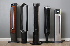Tower fan group against a wall (yourbestdigs) Tags: tower fan isolated cooling cold electric conditioning blow white cooler steam portable conditioner ionizer technology blowing equipment modern climate cool background electronics air condition