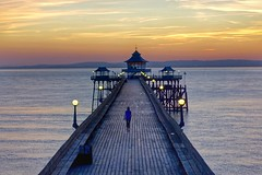The girl on the pier (explored) (Nige H (Thanks for 7.5m views)) Tags: bristolchannel coast sea cloud sky summersnight summer england somerset clevedonpier clevedon alone girl sunset pier landscape nature