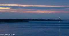 Good Morning (maureen.elliott) Tags: earlymorninglight lighthouse view gaspe quebec forillonnationalpark water ocean clouds skies light sunrise
