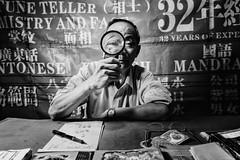Temple Street Fortune Teller (Hong Kong Eye) Tags: blackandwhitephotos garyjones monochrome people hongkong streetphotography monotone nikoncorporationnikond810 blackandwhite oct2016 candid
