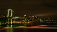 Boat Trails (elenaleong) Tags: rainbowbridge boattrails tokyobay tokyo elenaleong suspensionbridge minato shibaurapier