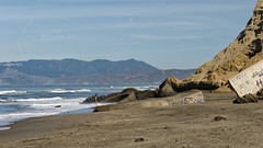 Down on the beach (LeftCoastKenny) Tags: fortfunston pacificocean beach sand hills ruins graffiti bather surfers ship