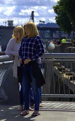 Bird's Eye View (swong95765) Tags: women ladies females mother daughter blonde gull bird seagull railing
