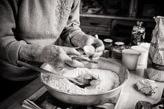 Ag Danamh Arin / Making Bread 06 (soilse) Tags: 2009 anghaeltacht cnocastolaire deireadhfmhair donegal dnnangall gaeltacht gweedore ireland mum october october2009 silverefexpro tateandlyle trchonaill agbacil agbriseadhuibheacha agdanamharin arm arn baking bakingtin basin blackandwhite blaosc blaoscuibh bread breadmaking ceird cisteanach cistin concentration craft daylight daylightportrait eggs eggshell flour glassjars greased greasedbakingtin greasedtin hands ingredients jars kitchen lmha makingbread monochrome naturallight plr portrait portraiture portrid raising scla shell sultanas table tins treacle tbla uibheacha irinn