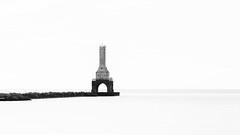 Lighthouse keeper, where have you gone? (John Westrock) Tags: blackandwhite lighthouse lakemichigan longexposure canoneos5dmarkiii canon135mmf2lusm bwnd1000x portwashingtonbreakwaterlight portwashington wisconsin