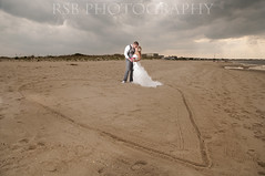 Rob and Maggi (Ryan S Burkett | RSB Photography) Tags: wedding beach cake photoshop de mirror coast engagement sand nikon kiss details east rings 1750 28 delaware 18 50 bounce prep fill blend facepalm cs6 pw3 d300s sb910 rsbphotography pocketwizard3