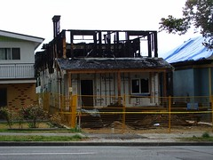 Burning the Midnight Oil (knightbefore_99) Tags: street city canada vancouver fire bc townhouse burning stop midnight oil anarchy development eastvan arson