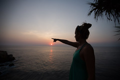 I think its over there.. (paul.wienerroither) Tags: sunset ocean oceanlove colors water sea travel girl silhouette reflection sun light sunlight sky view bali indonesia lemongan photography canon look