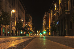 No Cars at the August's Green Light (filippogatteschi) Tags: street nighttime night summer empty nocars silence glowinglights center greenlight dark highlights yellow color colors arezzo tuscany italy travel ferie vacation holiday rest urbanlandscape perspective escapeline centerlane buildings streetlamps groundlevel warmth loneliness canoneos70d eos tamron2470 24 70 longexposure handheldexposure