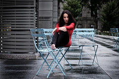 red dress and blue chairs (le cabri) Tags: reddress model woman young chairs blue brunette goodlooking chilling photowalkthisway quebeccity cityhall urban eyecontact bluechairs caucasian