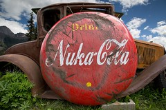 Drink Nuka Cola (Edmonton Ken) Tags: fallout nuka break cola ford moutain brand sign old antique round red white yellow blue sky cloud advertise advertising apocolyptic post show photoshop ancient drink nukacola model advertisment
