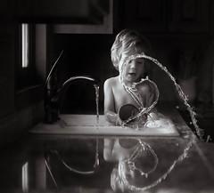 57/365 - A Little Splashy (kate.millerwilson) Tags: child sink kitchen water freezeaction highspeed lowlight monochrome naturallight windowlight family