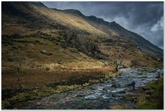 Capturing the moment (Hugh Stanton) Tags: stream mountain stormy sunlight burst valley