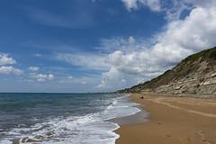 Agios Gordios beach (ORIONSM) Tags: agiosgordios beach corfu greece sand sea surf cliffs water blue azure sky clouds golden soft sony rx100mk3