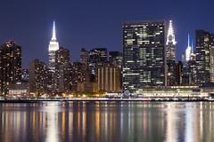 Standing Tall (salserasara) Tags: newyork newyorkcity nyc america unitedstatesofamerica empirestatebuilding chryslerbuilding lic longislandcity eastriver longexposure night river water architecture reflection usa