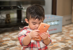 Portrait of little kid playing mobile phone (leykladay) Tags: adorable ages baby beautiful boy brother caucasian child childhood clothed crawl cute face handsome happiness happy honey image innocent joy joyful kid knowledge laugh learn little look lovely male portrait preschooler smiling studio sweet teeth toddler