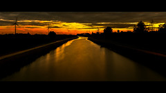 A river runs through it (Thierry Hudsyn) Tags: canon6d ef1635mmf4lisusm longexposure sunset aftersunset goldenhour canal windturbines oliennes cinematic cinematicphotography widescreen