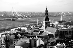 Riga - View from St. Peter's Church (fede_gen88) Tags: old city bridge panorama white black tower church river town nikon cityscape view cathedral bell latvia steeple campanile riga stpeter doms rga latvija daugava rgas d5100