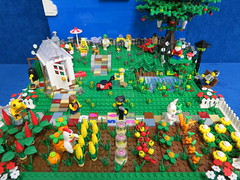 Lego Sping Garden (Mrs Wobblehead) Tags: flowers sky sun tree vegetables grass clouds garden fishing pond lego greenhouse lawnmower hopscotch sunbathing appletree moc swingball springgarden vegetablepatch minifigures