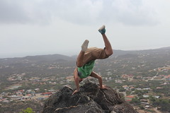 Rebel (Kacey_Oesterreich) Tags: cliff mountain rebel dangerous aruba edge handstand mountian onthe
