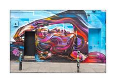Graffiti (Mr.Cenz), East London, England. (Joseph O'Malley64) Tags: mrcenz graffiti streetart eastlondon eastend london england uk britain british greatbritain wall walls wallmural brickwork muralist doors doorways entrances exits recesseddoorways steps gradient incline stepgradient pavement bollards stickers wiring lamp lintels tiling accesscover girl aerosol cans spray paint