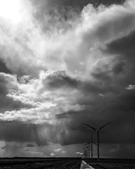 threatening sky (tvdijk19) Tags: blw clouds zwartwit zwart wit wolkenlucht donderbui zonnestraal windmolens windturbines polder flevoland nederland netherlands electriciteit groen energie iphone 6s apple wind