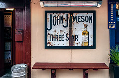 Mike Driscoll 2016 - Three Star (Michael Driscoll Jr.) Tags: jameson irish whiskey bench keg bar sign worn distressed colorful aged weathered vintage drinking ireland storefront sitting light