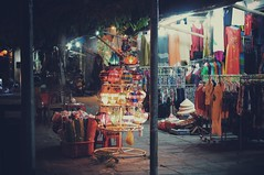 Promise of joy (wannieworks) Tags: sony nex yashica vietnam hoian ancienttown outdoor street shops clothes lanterns lights colors colorfullights night