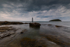 Penmon Lighthouse and Puffin Island (nigel.barry22) Tags: sky cloud sea ocean shore rock coast headland penmonlighthouse puffinisland blackpoint penmon menaistrait anglesey