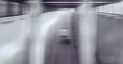 Leaving... (marcin baran) Tags: blur blurry focus out human person man awalk walking alone one lonely leave leaving corridor surface layer glass window lines leading color grey awesome original pov fuji fujifilm fujix100 x100 x100t street streetphotography streetphoto stranger composition urban city gliwice poland polska marcinbaran