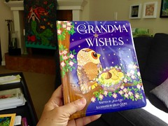 Countdown: Two Weeks (enovember) Tags: baby grandchild grandparent grandmother grandma book reading hardcover wishes wah
