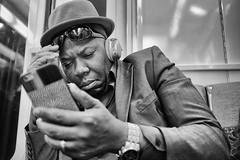 DSCF8396 copie (sergedignazio) Tags: france paris street photography photographie rue fuji x100s rer homme smartphone lunette chapeau